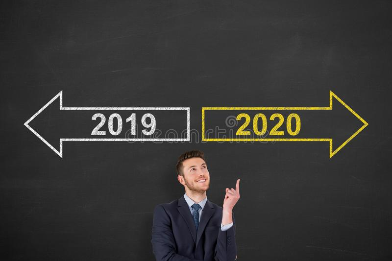 Old Year New Year 2020 over Human Head on Chalkboard Background stock photography