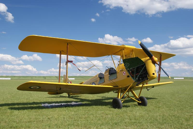 An old yellow biplane airplane from the early 20th century. royalty free stock images