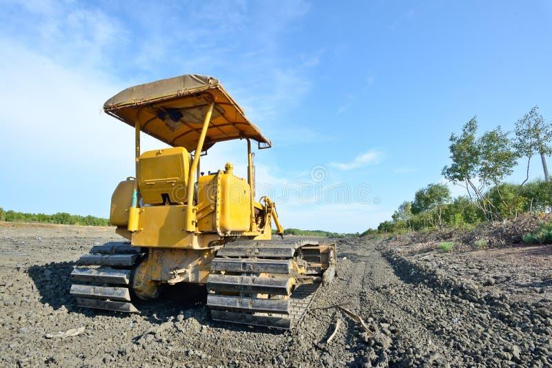 Old yellow bulldozer stock photo