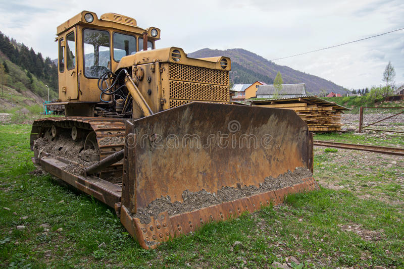 Old yellow bulldozer in the highlands royalty free stock photography
