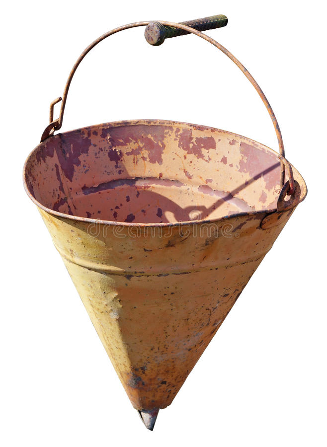 The old yellow hollow fire triangle bucket hangs on the nail. Sunny day outdoor shot. Isolated with patch royalty free stock images