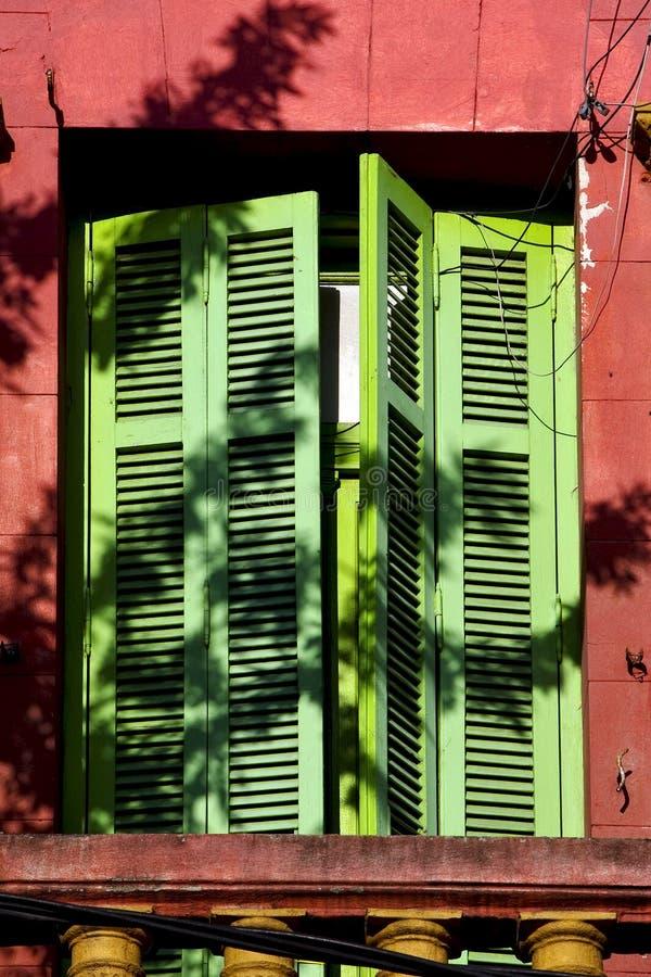 old yellow little terrace green venetian blind stock photo