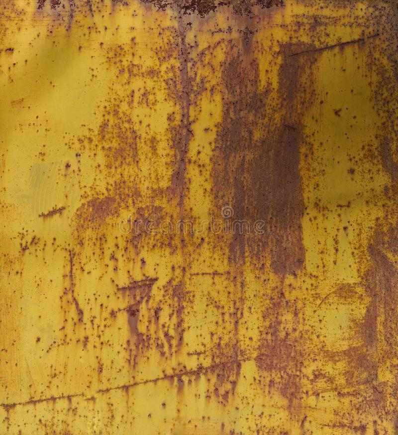 Old yellow painted wall with rust texture. Grunge rusted metal background royalty free stock image