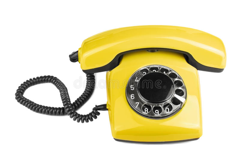 Old yellow phone isolated royalty free stock photo
