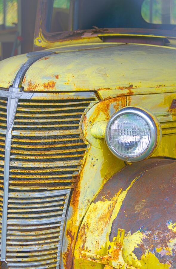 Free Old Yellow Rusty Chevrolet Pickup Truck Grille And Headlight Royalty Free Stock Images - 182349859