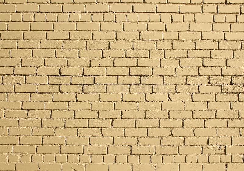 Yellow urban exterior brick wall surface texture background stock photography