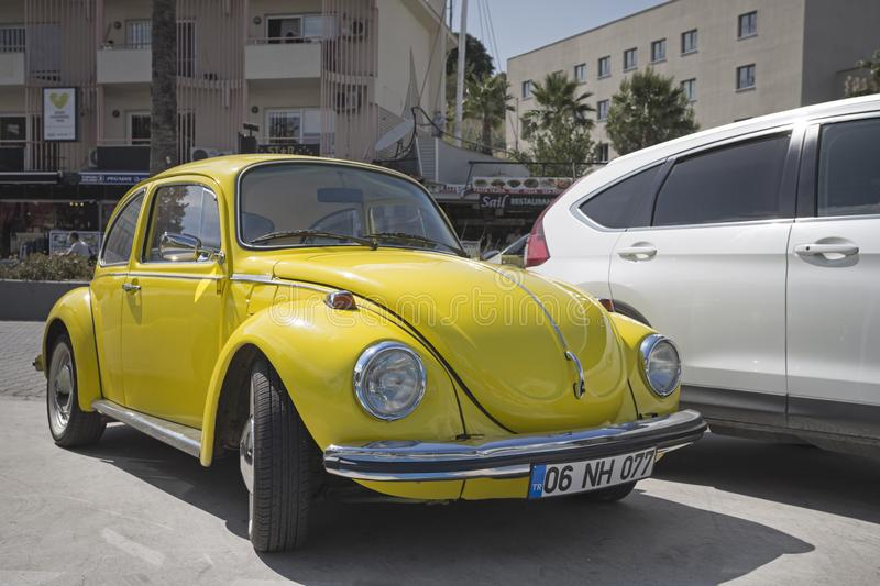 Old yellow Volkswagen Beetle royalty free stock photography