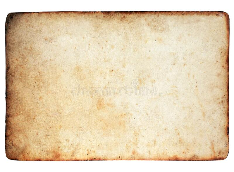 Old yellowed parchment paper with burnt edges .Texture or background royalty free stock photography
