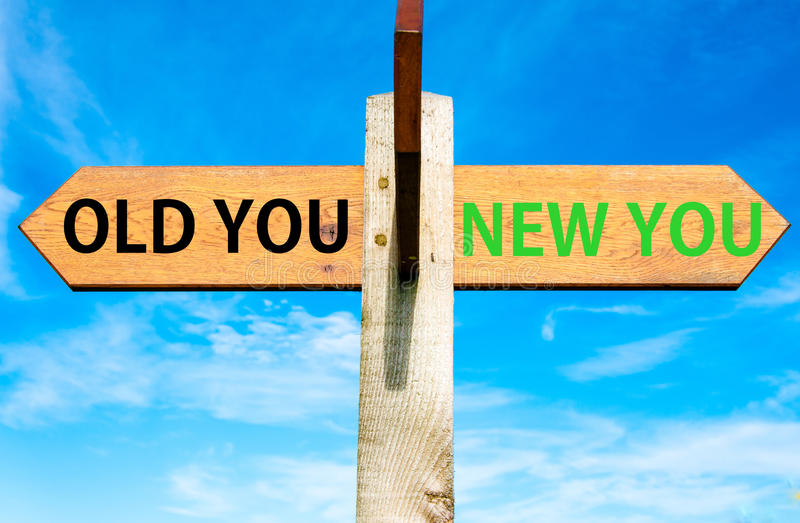 Old You and New You, Life change conceptual image. Wooden signpost with two opposite arrows over clear blue sky, Old You and New You, Life change conceptual royalty free stock photo