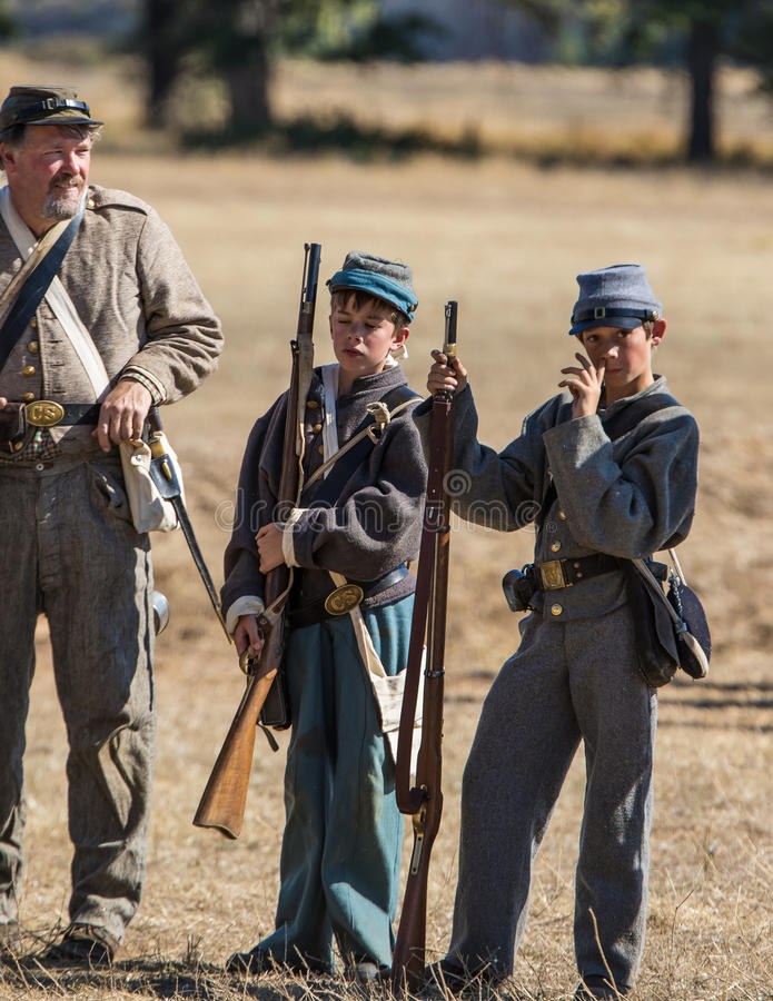 Old and Young. Civil War era soldiers after the battle at the Hawes Farm reenactment in Red Bluff, California stock photography