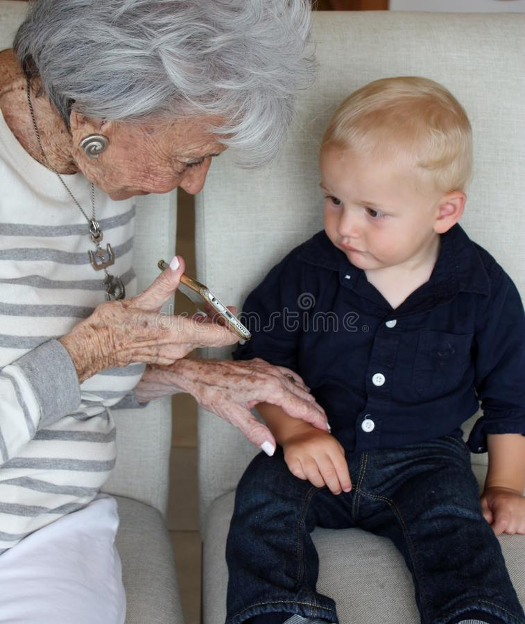 Old and Young enjoying modern technology stock photos
