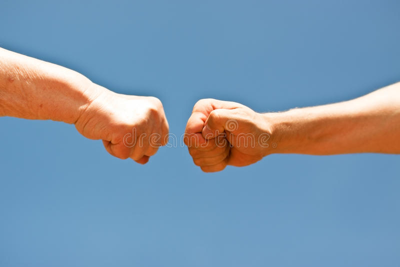 Download Old And Young Fists Punching Each Other Stock Image - Image: 25669431