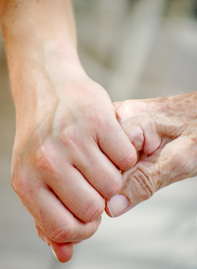 Old and Young Hand. Young Woman give Grandma her Hand royalty free stock photography