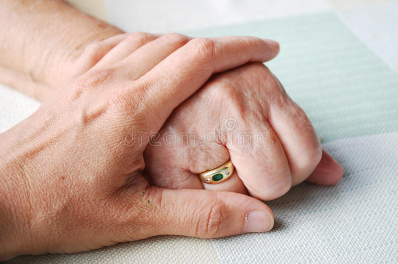 Old and young hand stock images