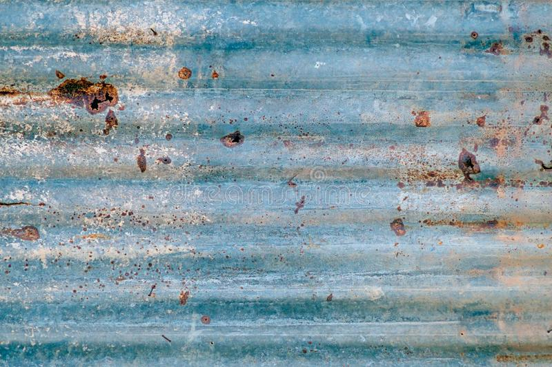 Old zinc roof, blue rusty metal wall stock photography