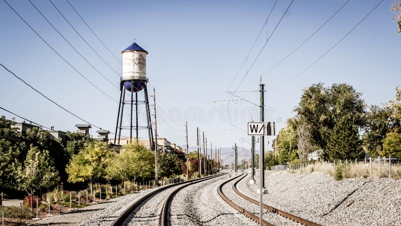 Olde town arvada Colorado water tower and train tracks. Olde town arvada water tower with train tracks racing away in the foreground stock photos