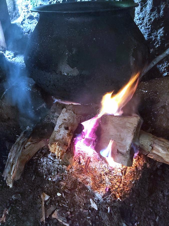 Olden days method of cooking food when there was no gas and electricity to cook food, some place in Himalayan they use fire wood. Olden days method of cooking stock photography