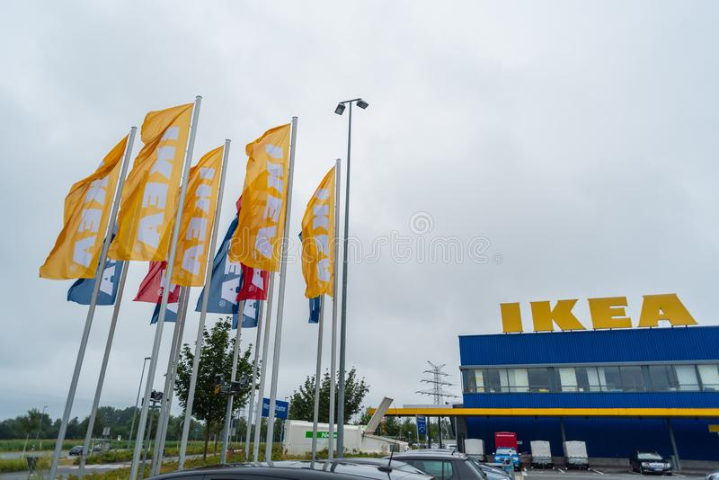 Oldenburg, Lower Saxony, Germany - July 13, 2019 IKEA flags near the IKEA Store. IKEA is the world`s largest furniture retailer, stock photos