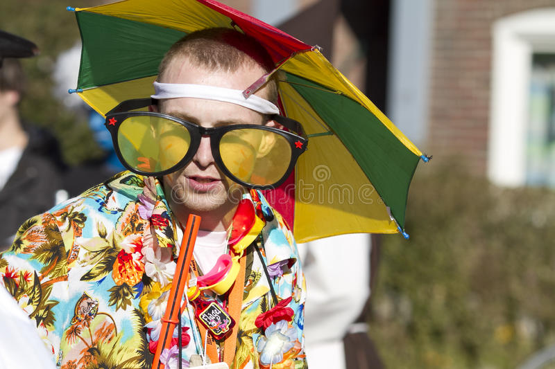 OLDENZAAL, NETHERLANDS - MARCH 6, 2011: People in colourful carnival dress during the annual carnival parade in Oldenzaal, Nether. Lands royalty free stock image
