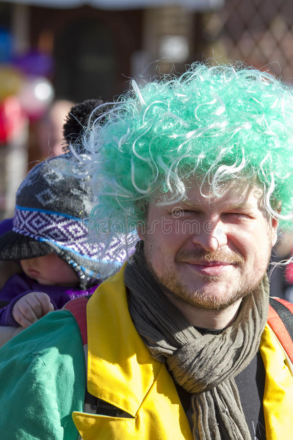 OLDENZAAL, NETHERLANDS - MARCH 6, 2011: People in colourful carnival dress during the annual carnival parade in Oldenzaal, Nether. Lands royalty free stock photography