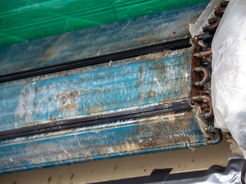 Older air conditioner in the wash. After not maintaining it for a long time. Dusty interior And the parts are rusty. Accumulating royalty free stock photography