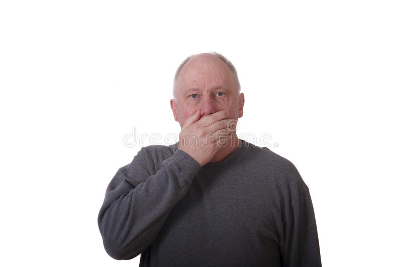 Older Bald Man in Gray Shirt with Hand Over Mouth stock images