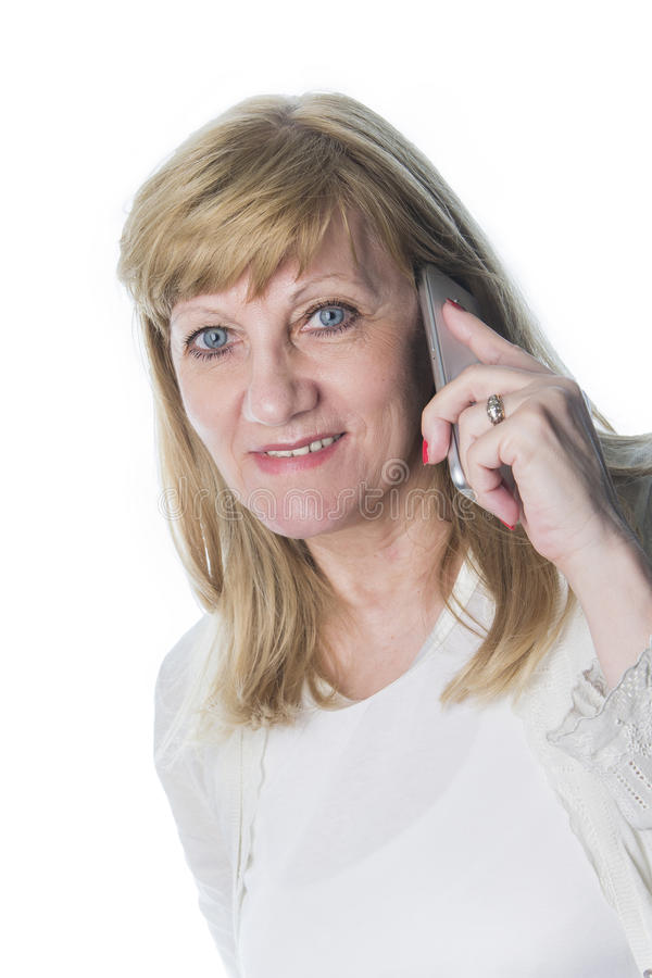 Older blonde woman talking on the phone stock images