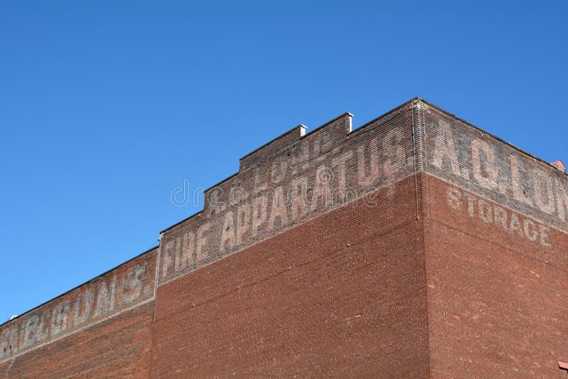 Faded advertising on a brick building in Portland, Oregon. This is an older brick building in downtown Portland, Oregon with faded painted advertising against a stock images