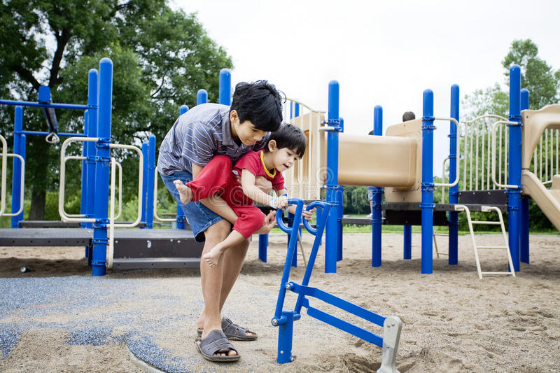 Older Brother Helping Disabled Sibling Royalty Free Stock Images