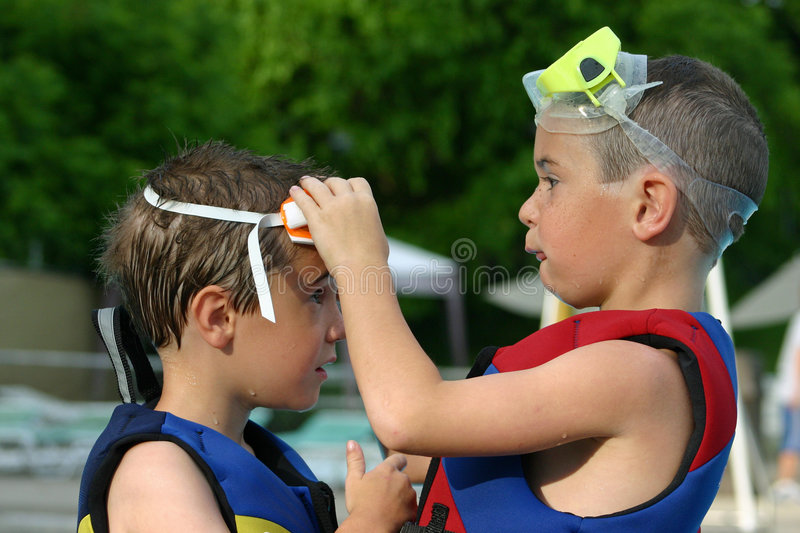 Download Older Brother Helping Younger Stock Photo - Image: 1383656