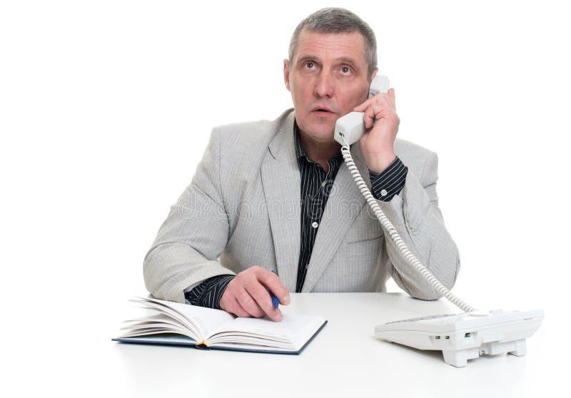 Older business man sitting stock photos