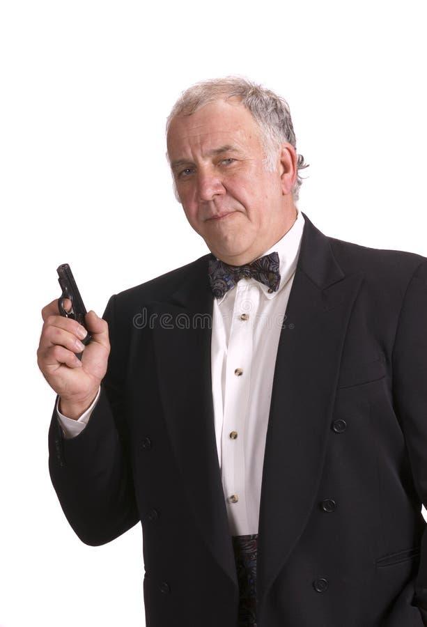 Download Older Businessman Impersonating James Bond Stock Image - Image: 5680323