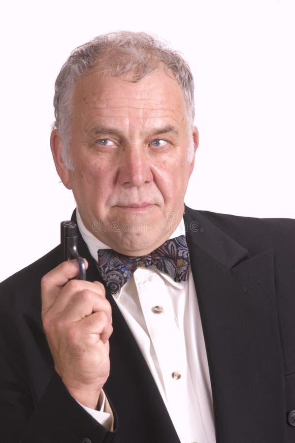 Download Older Businessman Impersonating James Bond Royalty Free Stock Photo - Image: 5736305