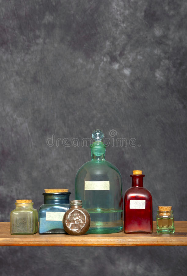 Older colored glass bottles in a laboratory stock photography