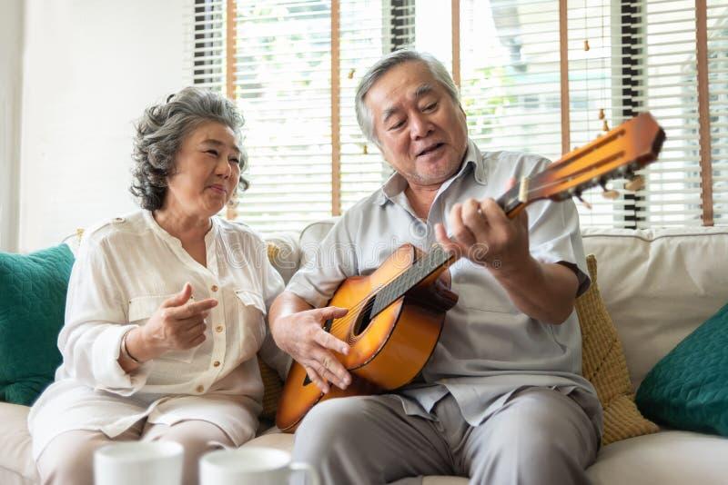 Older Couple enjoying with singing and guitar. stock photo