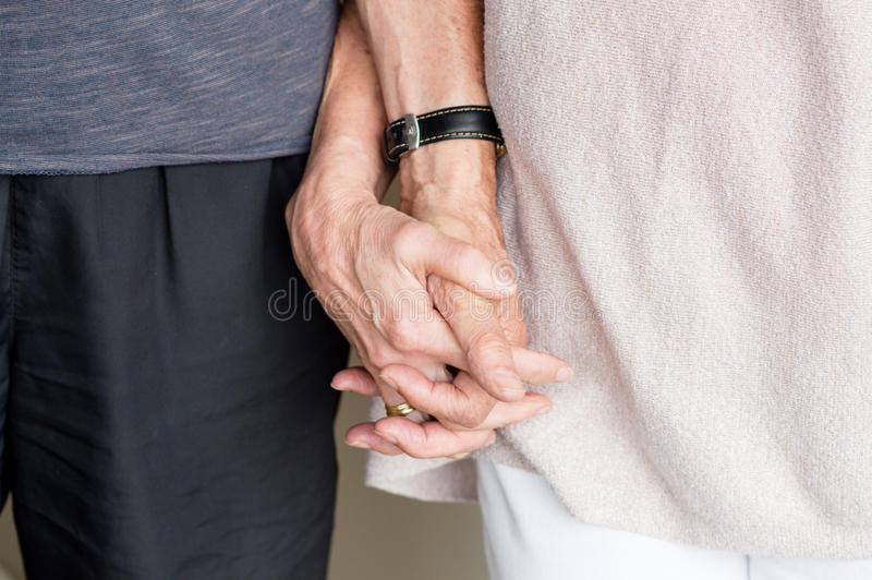 Older couple holding hands royalty free stock photos