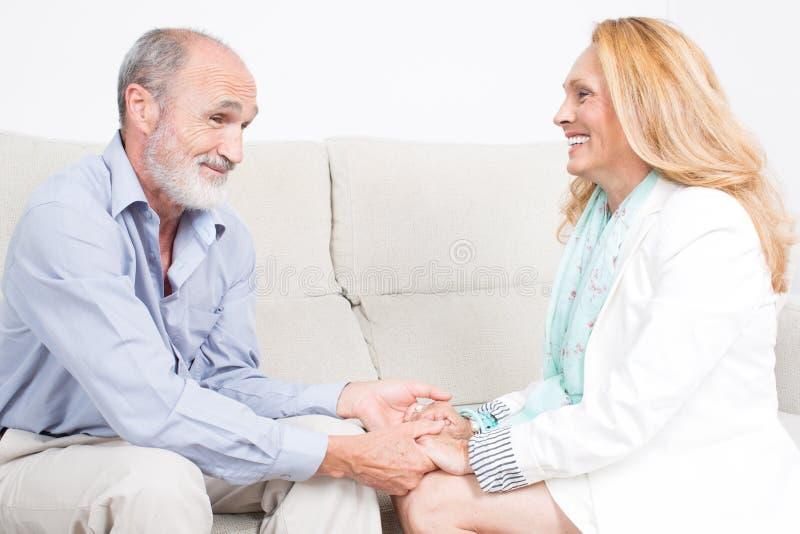 Older couple talking royalty free stock photos