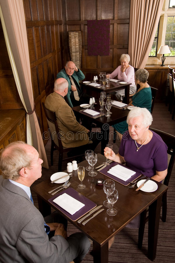 Older couples in restaurant stock image