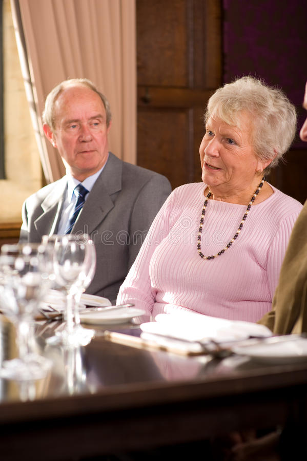 Older couples in restaurant royalty free stock photos