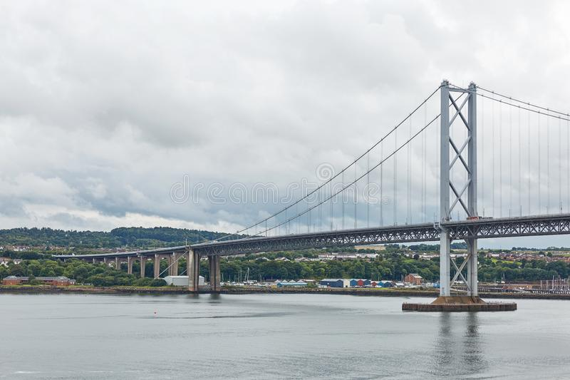 Older Forth Road bridge in Edinburgh Scotland.  stock photography