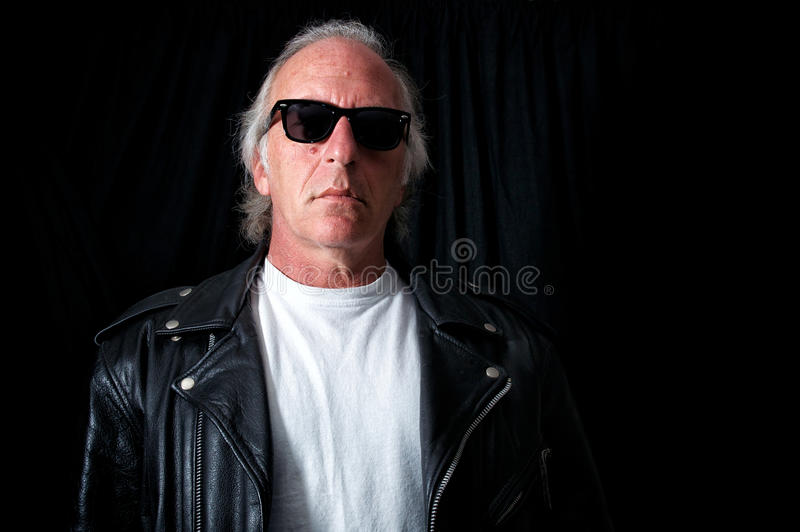 Older grey haired biker stock photo