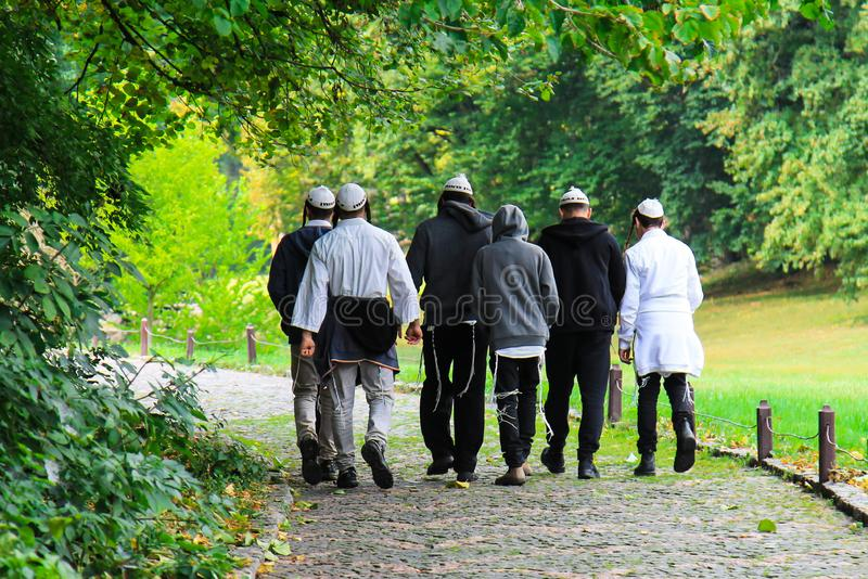 Older Hasidic Jews walk in the park during the Jewish New Year in Uman, Ukraine. Religious Jew. Older Hasidic Jews walk in the Sofia park during the Jewish New royalty free stock images