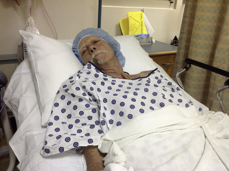 Older male hospital patient awaiting surgery stock images