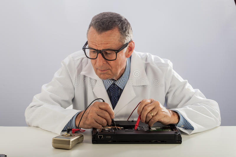 Senior Technician With Glasses, Repairing Computer Stock Photography