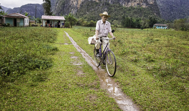 Older Man on Bicycle, Vinales, Cuba royalty free stock photography