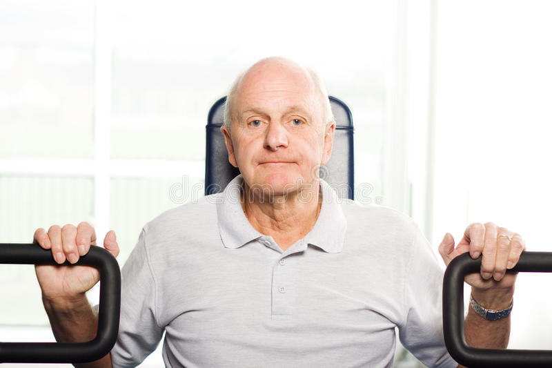 Download Older Man Exercising At The Gym Stock Photo - Image: 10472530