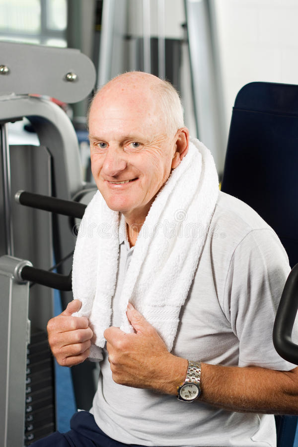 Older Man Exercising At The Gym Royalty Free Stock Photography