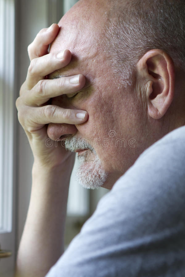 Older man expressing pain or depression, vertical royalty free stock photos