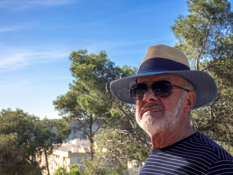 Older man looking at nature close-up stock images