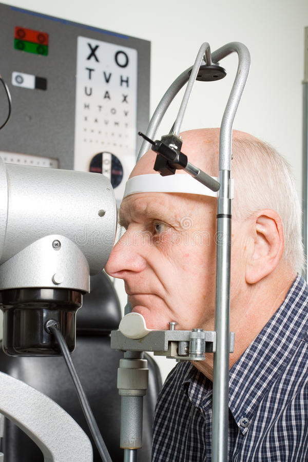 Older man having eye examination royalty free stock image
